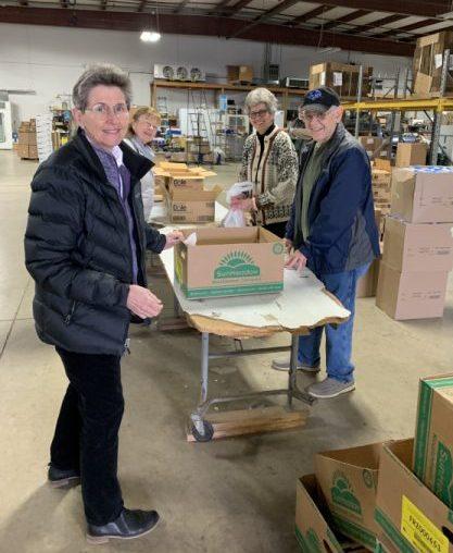 volunteers at work loading boxes